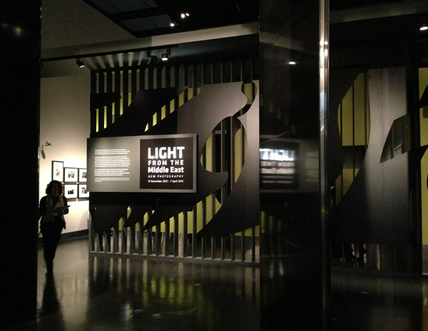 Light From the Middle East: Contemporary photography. Exhibition at the V&A museum in london. 2D graphics designed by Tarek Atrissi Design. Entrance mural to the typographic space shown in this photo.